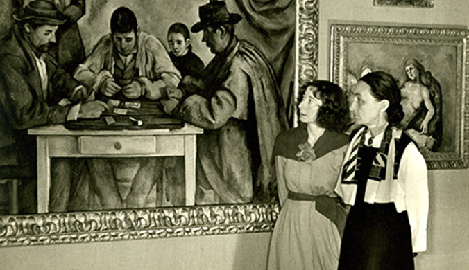 Violette de Mazia and Georgia O'Keeffe looking at Cezanne's The Card Players.fw